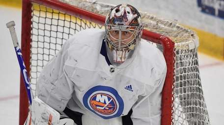 Islanders goaltender Semyon Varlamov protects the net during