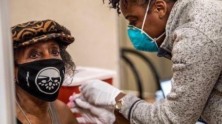 Sharin Bonner, of Westbury, gets her first dose
