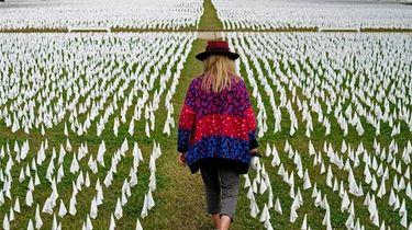 Artist Suzanne Brennan Firstenberg walks among thousands of