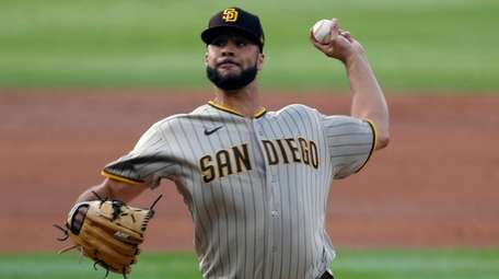 Then-Padres starting pitcher Joey Lucchesi throws to a