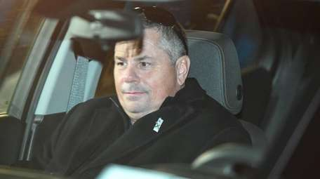 Thomas Fee is seen inside a vehicle after