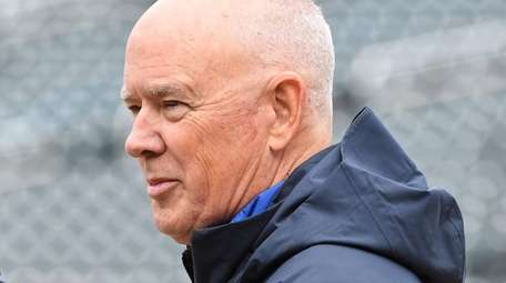 Mets general manager Sandy Alderson looks on during