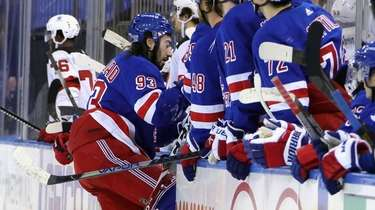 The Rangers' Mika Zibanejad leaves the ice with