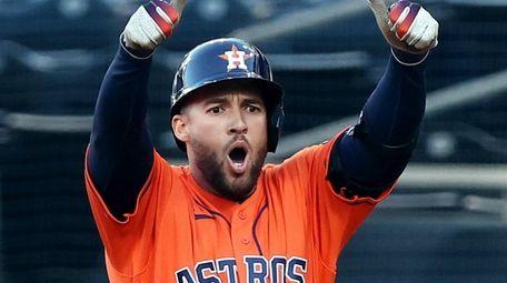 George Springer of the Houston Astros celebrates a