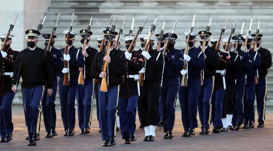 Members of the military honor guard practise ahead