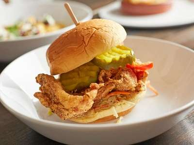 The fried chicken sandwich with coleslaw, bread and