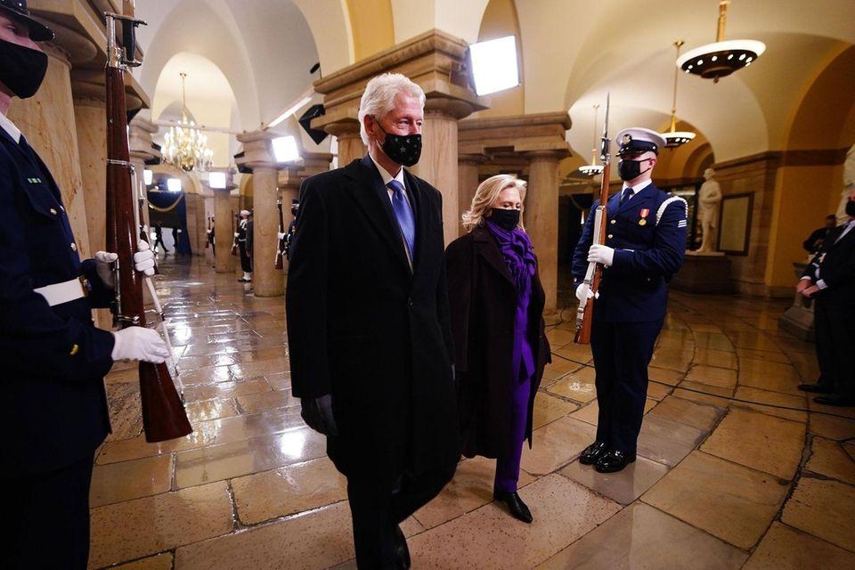 Former President Bill Clinton (L) and former Secretary