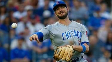 Kris Bryant of the Chicago Cubs throws for