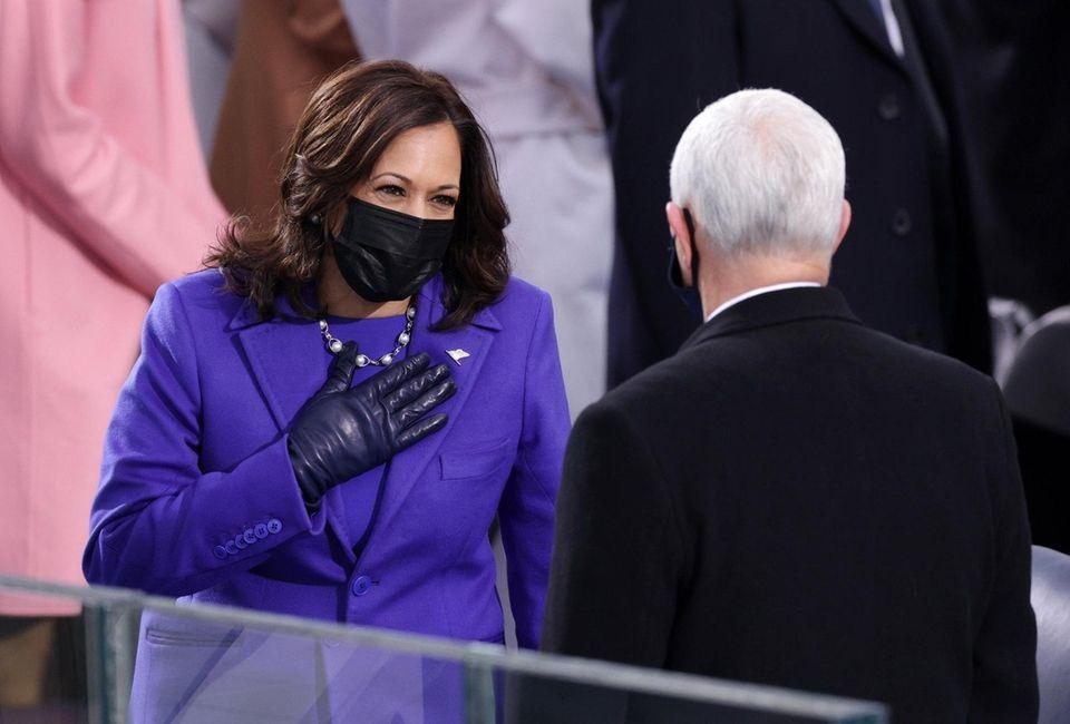 U.S. Vice President-elect Kamala Harris greets Vice President