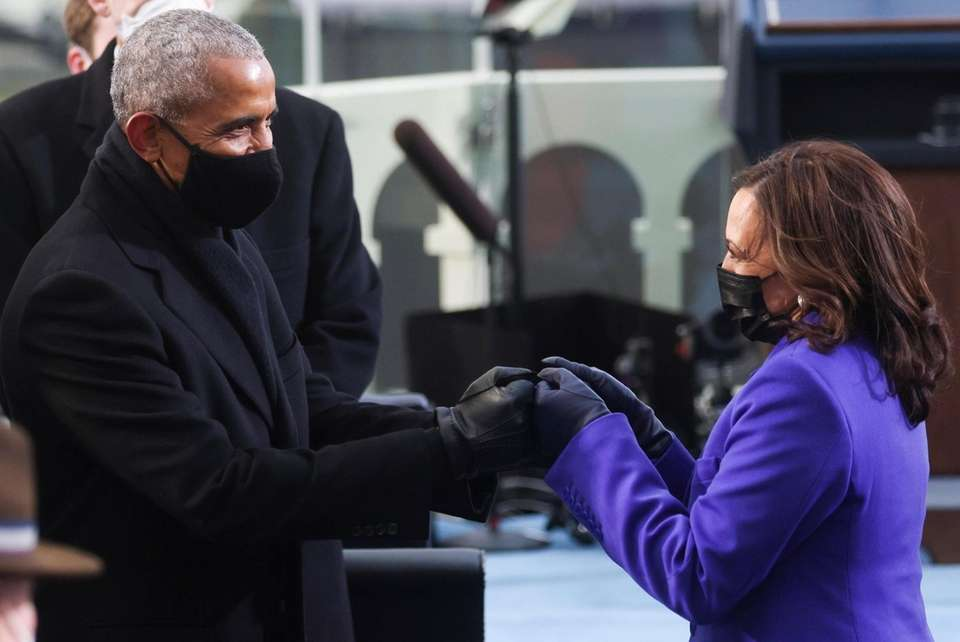 Former President Barack Obama greets Vice President-elect Kamala