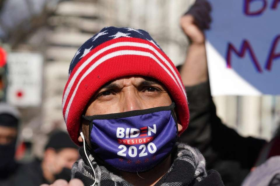 A supporter looks on during U.S. President Joe