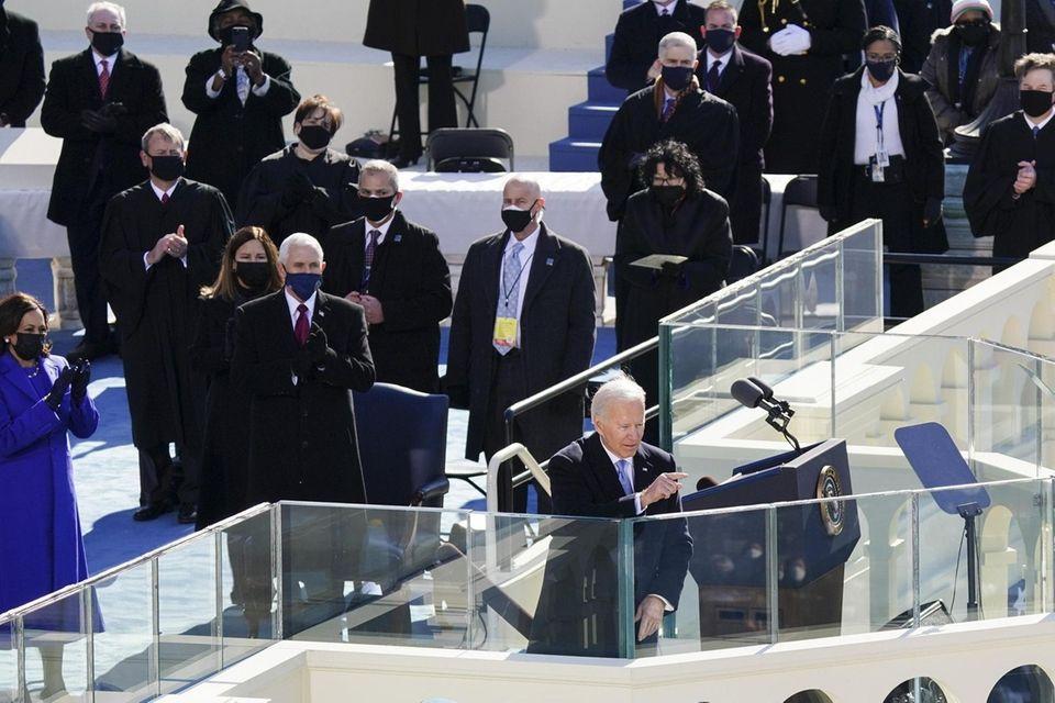 U.S. President Joe Biden gestures after speaking during
