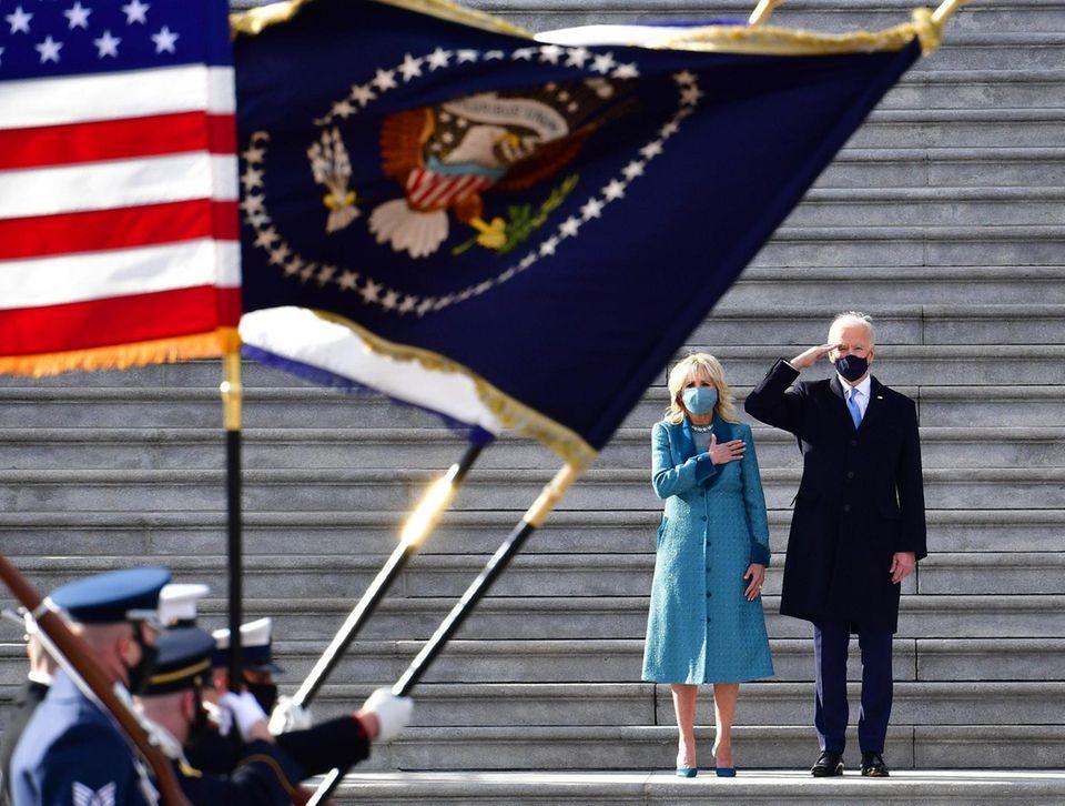 President of the United States Joe Biden salutes