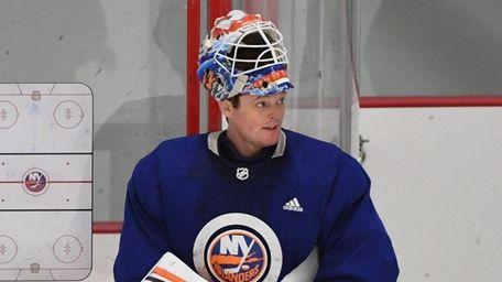 Islanders goaltender Cory Schneider looks on in a