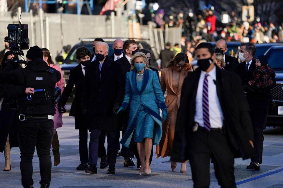 President Joe Biden walks with first lady Jill