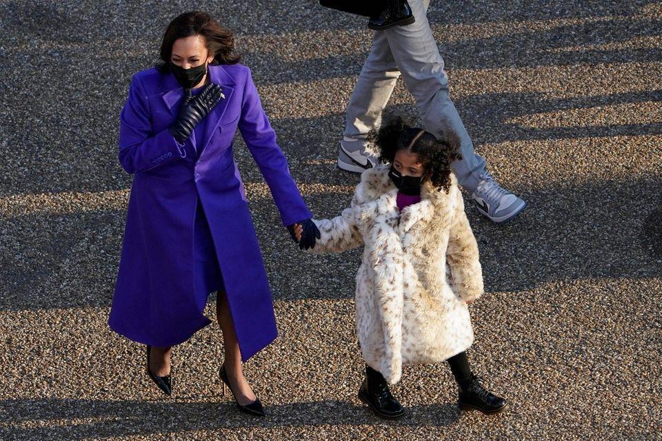 Vice President Kamala Harris walks in the parade