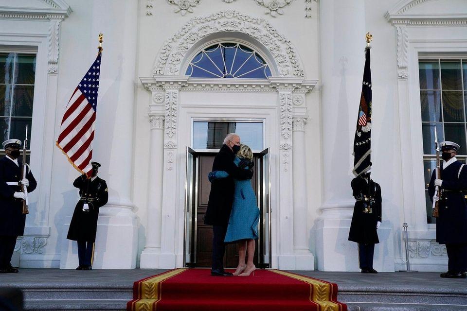 President Joe Biden hugs first lady Jill Biden