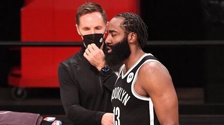 Nets head coach Steve Nash talks to guard