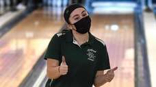 Nicole Karaman of Seaford reacts after rolling a