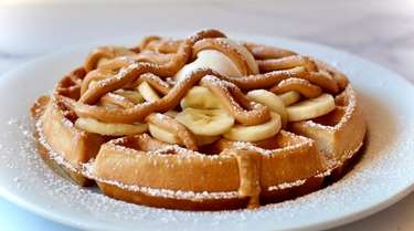 Waffles, here topped with bananas and peanut butter,