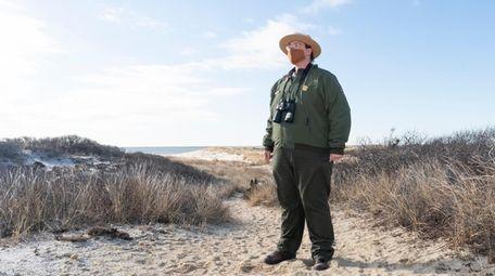 Ranger Kelsey Sucenat walks on the trail that