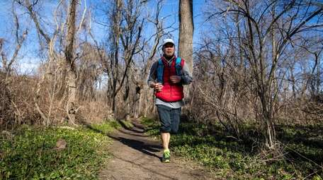 A man runs at Trail View State Park
