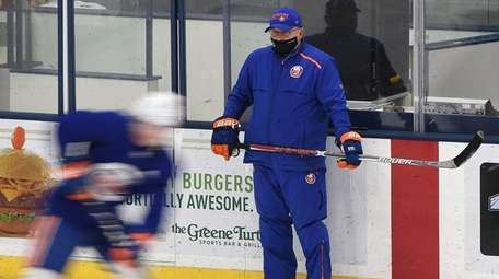 Islanders head coach Barry Trotz observes action at