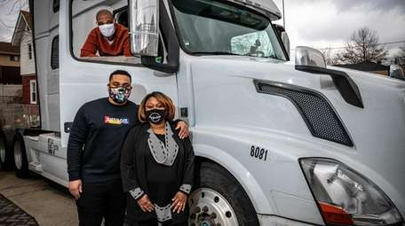 Elizabeth Wellington and her husband, Antonio, in truck,