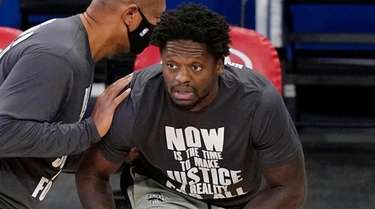 Knicks forward Julius Randle works with a trainer