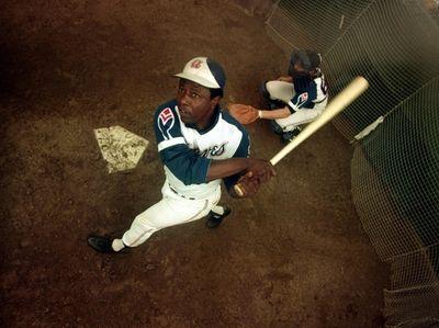 Atlanta Braves outfielder Hank Aaron swings a bat
