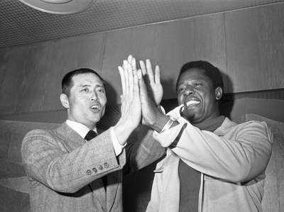 American home run king Hank Aaron, right, and