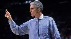 North Carolina head coach Matt Doherty signals from