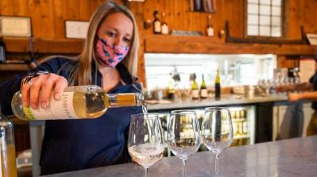 Rachel Sunday pours samples of wine at Jamesport