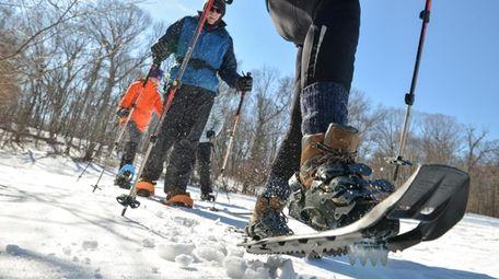 Tish McCrea, 50, of Huntingotn, hikes in snow