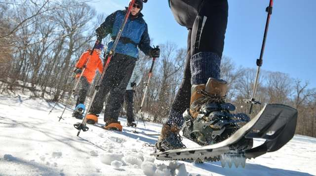 Tish McCrea, 50, of Huntingotn, hikes in snow