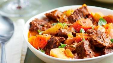 Chunks of chuck roast, carrots, parsnip, and potatoes