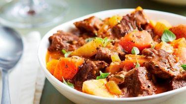 Chunks of chuck roast, carrots, parsnip, and potatoes