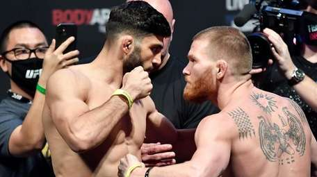Arman Tsarukyan, left, and Matt Frevola face off