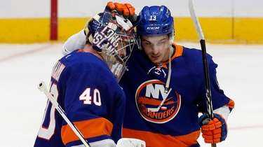 Semyon Varlamov and Mathew Barzal of the Islanders