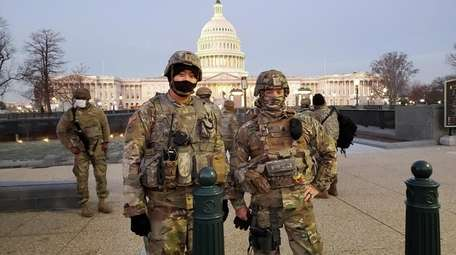 1st Sgt. John O'Dougherty, right, whose civilian job