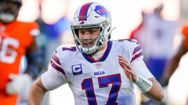 Bills quarterback Josh Allen runs against the Broncos