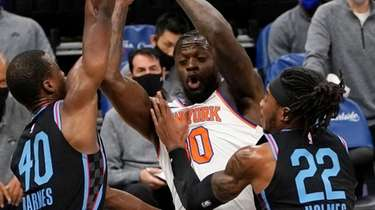 Knicks forward Julius Randle, center, is double-teamed by