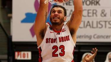 Jaden Sayles of the Stony Brook Seawolves dunks