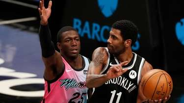 Kyrie Irving of the Brooklyn Nets controls the