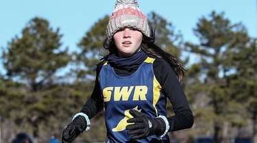 Shoreham-Wading River's Emily Cook crosses the finish line
