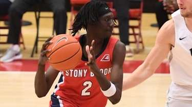 Stony Brook forward Mouhamadou Gueye drives to the