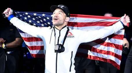 Michael Chandler battles Dan Hooker at UFC 257
