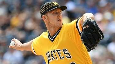 Jameson Taillon of the Pittsburgh Pirates delivers a