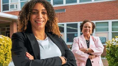 Social and emotional learning specialist Kelly Urena, left,