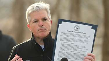 Suffolk County executive Steve Bellone holds up a